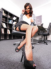 Prodigious babe Lou Charmelle stripping and masturbating in her office
