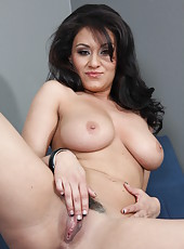 Dark-haired and pale skinned milf Charley Chase shows off her big natural boobs and shaved pussy