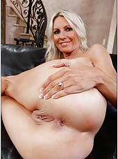 Cheeky blonde Emma Starr showing cool legs and masturbating on camera