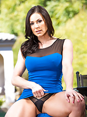 Tasty milf Kendra Lust undressing herself outside on a sunny weather