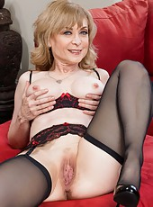 Gifted housewife Nina Hartley stripping in black stockings and masturbating