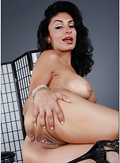 Classy flapper Persia Pele gets fully naked and spreads shaved pussy