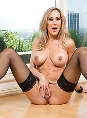 Adventurous slut Brandi Love is doing a striptease and masturbating hard
