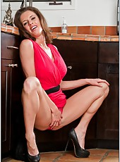 Winning hooker Veronica Avluv posing and masturbating in the kitchen