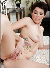 Pretty dark haired milf Charlie James plays with her wet pussy