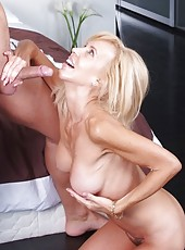 Cocky mature Erica Lauren hangs out with young boys and swallows cocks