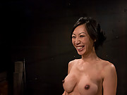 Hot, tan, big-breasted Asian Tia Ling is bound, impaled.
