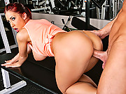 Hot redhead gets slammed in the gym