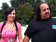 Sassy little brunette slut struts Ron Jeremy donw the street and fucks him
