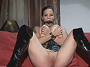 Busty hot wild Mandy May poses her body in kinky latexwear