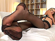 Horny blonde in stockings rubbing her feet agains her pussy