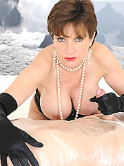 Busty booted dominatrix