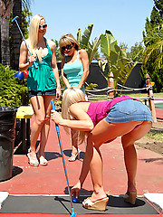 Hot mini skirt lesbians dildo fuck in these hot 3some mini golf fuck pics
