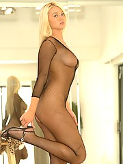Alison Angel poses in a fishnet body suit