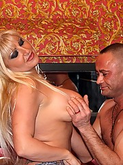Massive titted blonde hooker gives an Italian an handjob