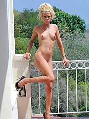Kori shows off her shaved pussy