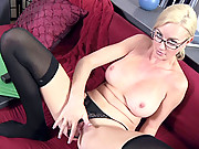 Elegant blonde cougar uses a glass toy to satisfy her pussy