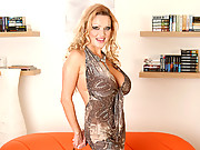Sharon Pink exposes her huge milf tits and masturbates with a dildo