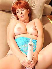 Hot tempting redhead Calliste torments her cougar pussy with her favorite sex toy