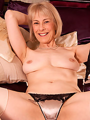 Horny mature blonde strokes her pink mature pussy with a glass dildo in hot solo action