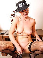 Horny policewoman plunges a billy club in her fuck box before she takes off her undies