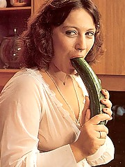 Two hairy seventies ladies using cucumbers