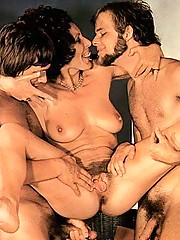 Four horny guys fucking two hairy retro girls