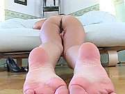 Horny brunette Eve Angel glass dildoing her pussy on sofa