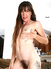 Hairy and petite Lacy from AllOver30 tugs at her mature pussy hair