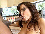 Brunette babe Lisa Ann rides a huge black cock before getting facialized