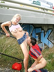 Blonde girl is having naughty sex near the crowded highway