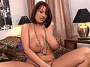 Busty brunette babe LaTaya Roxx exciting her shaved pussy