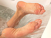 Blond babe Ulrika playing with her hot legs & feet in bath