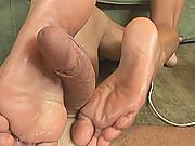 Tanned Shlina Devine doing footjob & gets her feet cummed