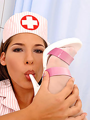 Nasty brunette nurse Zafira doing footjob in doctor