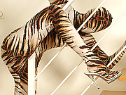 Flexible Pornstar Sandy in tiger spandex