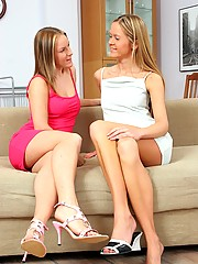 Two cute girls fucking intensely on the couch
