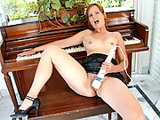 Classy piano teacher uses the magic wand on her pussy prior to a lesson