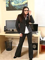 Stephanie Swift slips off her pinstripe suit