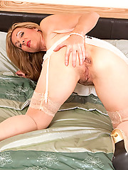 Sex starved cougar Camilla shoves a big suction cup dildo deep inside of her hairy juice box