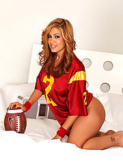 Isis Taylor in a football jersey in bed teases the camera