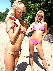 Two hot beach babes horny playing in the sand