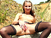 A horny outdoor babe masturbating on a rock