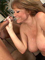 Redheaded cougar slut opens her long legs wide and gets her pussy fucked by a younger man