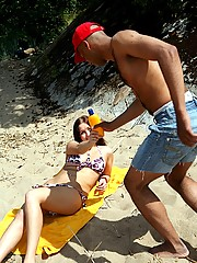 A cutie sucking really big cock on the beach