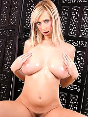 Horny blonde oiling her big massive boobies