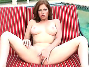 Ginger Blaze spreads her pink while outside by the pool