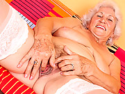 Big titted grandma plays with her boobs and her old pussy