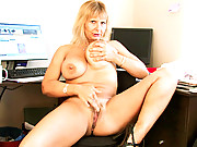 Horny executive takes a break to play with her huge tits and pussy