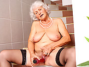 Granny with big tits stuffs her hairy pussy with a vibrator